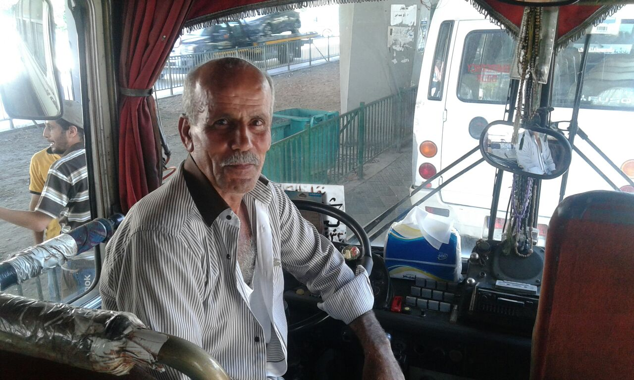 This is Ali, a driver we met while scanning the hub; he drives the oldest bus in Cola, dating back to 1973.